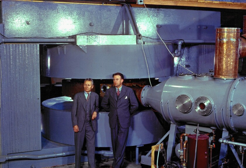 Ernest O. Lawrence, right, the inventor of the cyclotron, stands before the machine with a top assistant, Donald Cooksey, at the UC Berkeley campus in 1939.