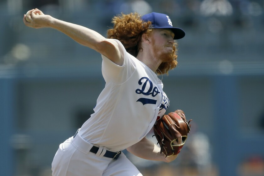Dodgers pitcher Dustin May throws to a St. Louis Cardinals batter during the first inning on Aug. 7 at Dodger Stadium.