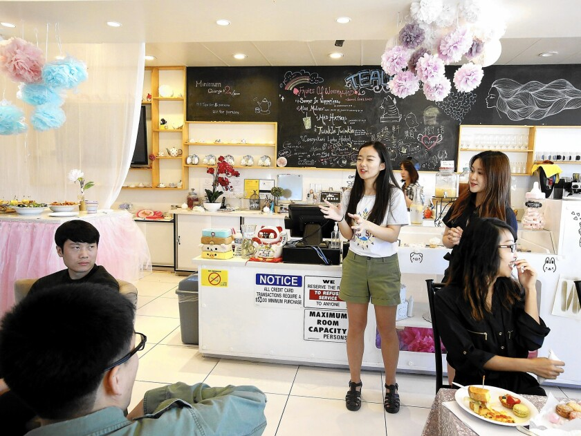 Single men and women gather at Lin's Wonderland Tearoom in the City of Industry for an event sponsored by the Chinese-language dating site 2RedBeans.