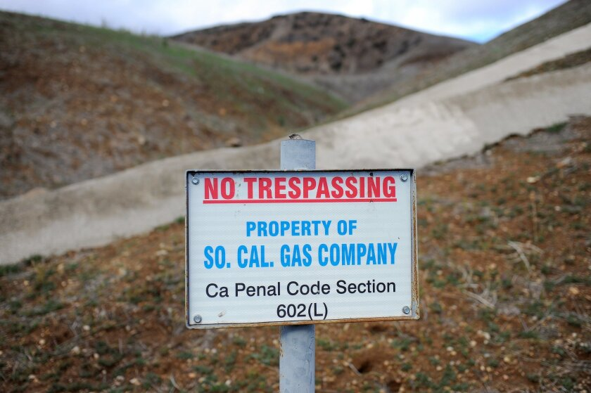 FILE--In this Jan 7, 2016, file photo, a sign declares the boundary line of the Southern California Gas Company gas fields where a natural gas well leaked methane near the community Porter Ranch. (AP Photo/Michael Owen Baker, file)