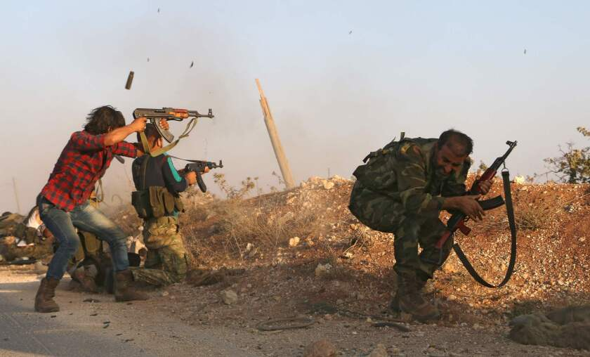 Syrian soldiers fire, repelling an attack in Achan, Hama province