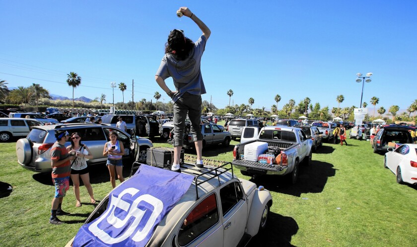 Chris Heredia, 19, of San Diego gets the party started as cars and people descend on the Empire Polo Grounds in Indio for the three-day Coachella Music and Arts Festival, which starts Friday.