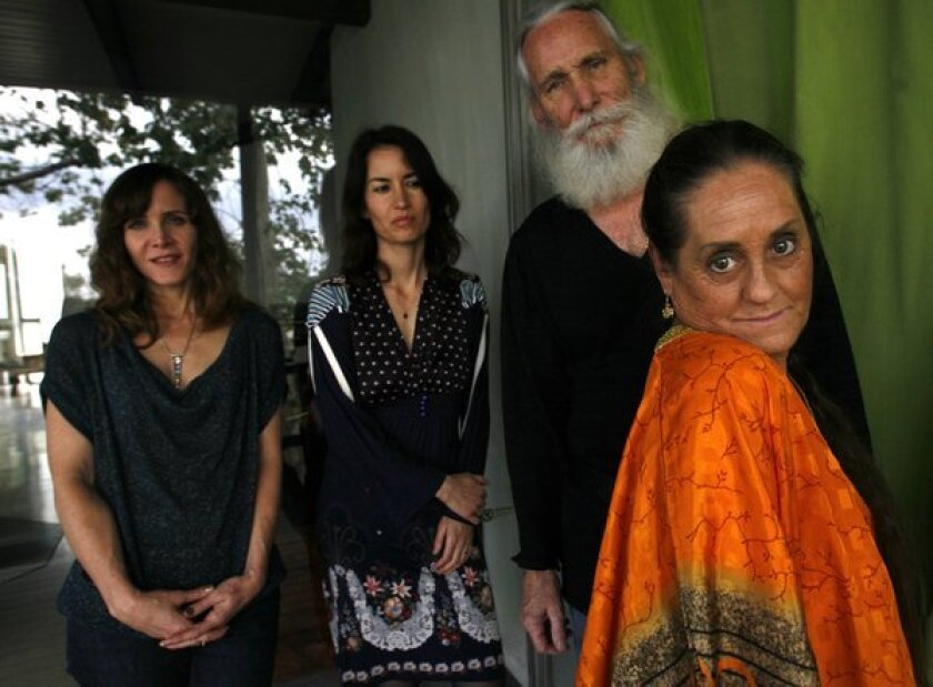 """""""The Source Family,"""" a film about the LA-based 1970s cult and the popular health food restaurant they ran, made it's Los Angeles debut on May 10. Directed by Maria Demopoulos and Jodi Wille, archival material was provided by former member Isis Aquarian and Electricity Aquarian (not related). The group, Jodi Wille, Maria Demolopoulos, Electricity Aquarian and Isis Aquarian, left to right, together at Maria Demolpoulos' home."""