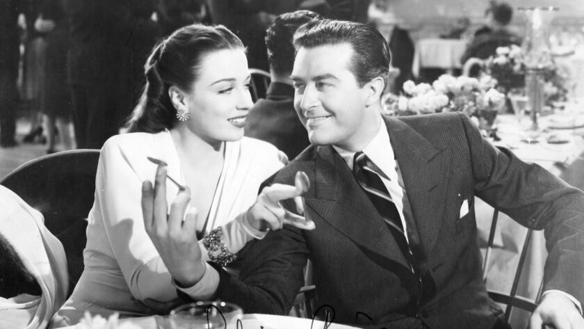 Patricia Morison and Ray Milland in the movie Are Husbands Necessary. 1942.