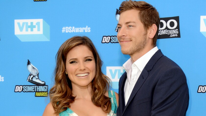 Dan Fredinburg, right, who was killed in this weekend's avalanche on Mt. Everest, at an L.A. event in 2013 with actress Sophia Bush.