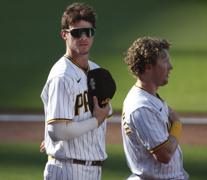 Wil Myers, left, and Jake Cronenworth of the San Diego Padres line up for the national anthem