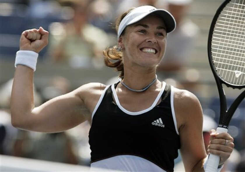 FILE -- In this Aug. 30, 2007 file photo, Swiss tennnis player Martina Hingis celebrates after defeating Pauline Parmentier of France at the US Open tennis tournament in New York.  Five-time Grand Slam singles champion Hingis heads the 2013 class for the International Tennis Hall of Fame. The other