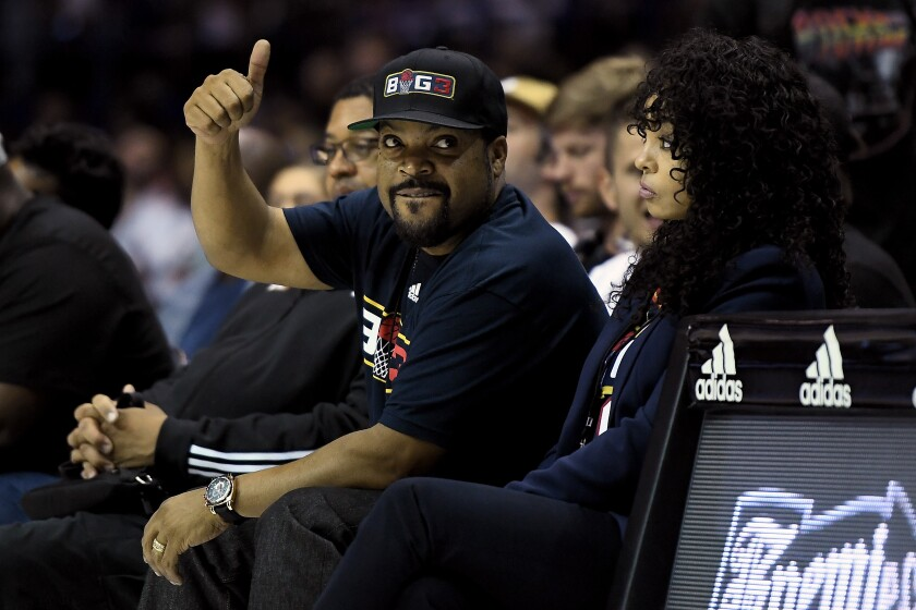 Ice Cube and wife Kimberly Woodruff look on during a Big3 three-on-three basketball league game on Aug. 3 in Chicago.
