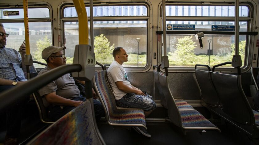 LOS ANGELES, CA - APRIL 26, 2019: Byron Taylor, right, rides the Metro bus 2 to get to his job at