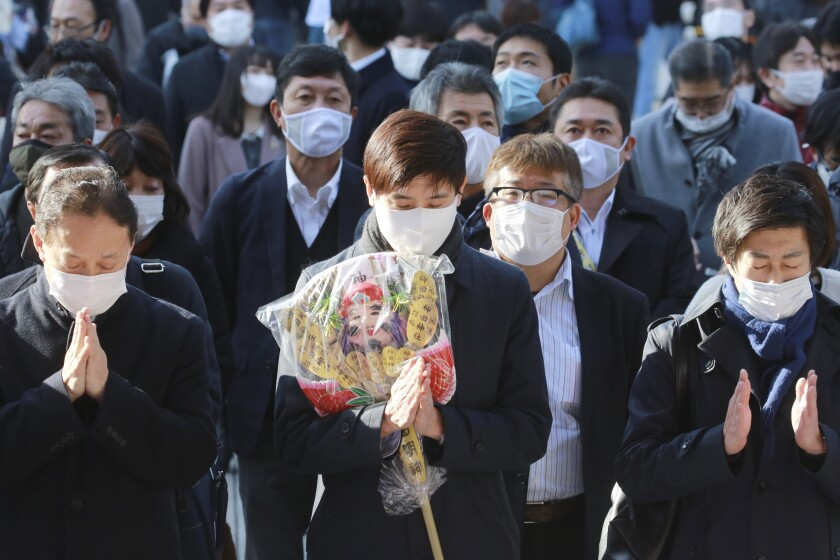 People wearing face masks to protect against the spread of the coronavirus offer prayers for New Year at the Kanda Myojin Shrine on the first business day of the year, in Tokyo, Monday, Jan. 4, 2021. Kanda Myojin is known as the shrine of commerce and industry. (AP Photo/Koji Sasahara)