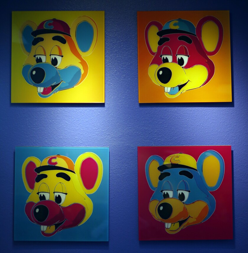 Chuck E. Cheese painting at Chuck E. Cheese pizzeria in Dallas