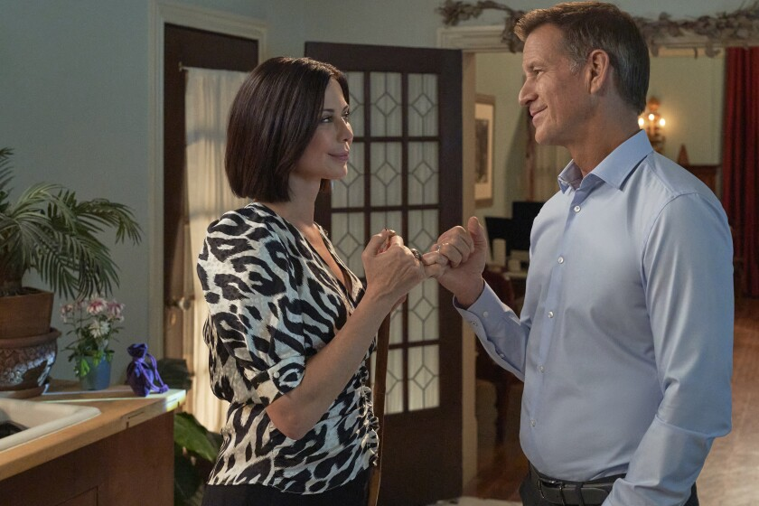 """Catherine Bell and James Denton in """"Good Witch"""" on Hallmark Channel."""