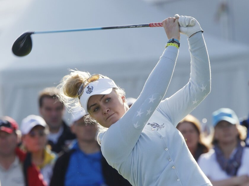 Europe's Charley Hull from Britain follows the ball after teeing off in the foursomes on Day1 of the Golf Solheim Cup in St.Leon-Rot, Germany, Friday, Sept. 18, 2015.(AP Photo/Michael Probst)