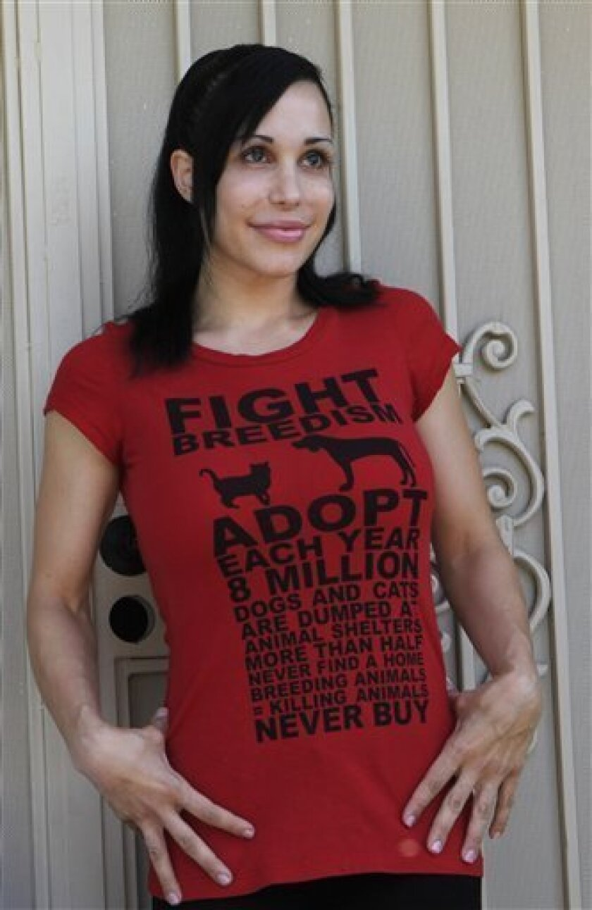 "FILE - In this file photo taken May 19, 2010, ""Octomom"" Nadya Suleman wears a t-shirt promoting pet birth control outside her home in La Habra, Calif.  Suleman has checked herself into a rehabilitation center, citing anxiety, exhaustion and stress. A statement from Suleman's spokeswoman Gina Rodrig"