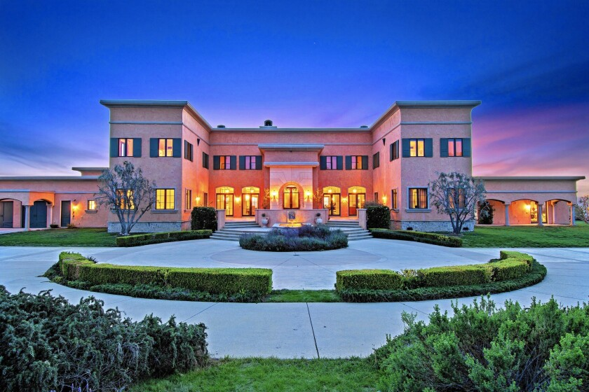 Grammy-winning record producer Matt Serletic is asking $6.995 million for his estate of more than 10 acres in Calabasas. The Italianate-style home sits atop a knoll and takes in 360-degree views of the surrounding area.