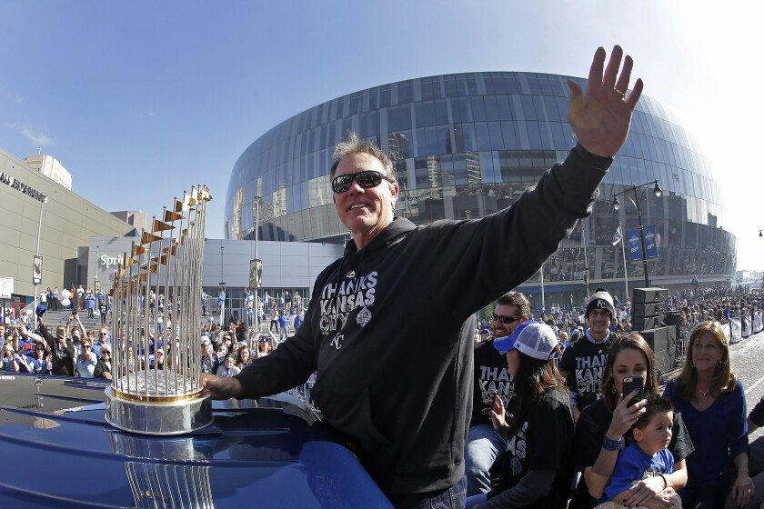 FILE - In this Nov. 3, 2015, file photo, Kansas City Royals manager Ned Yost waves to the crowd during a parade celebrating the Royals winning baseball's World Series, in Kansas City, Mo. Yost did something that few thought possible when he took over the Kansas City Royals in 2010: He not only built the organization into a winner but delivered the long-suffering organization its first World Series title in three decades. Now, he's leaving the next rebuilding job to someone else. Yost announced Monday, Sept. 23, 2019, that he will be retiring at the end of the season, ending a nine-year tenure that included two American League pennants and that dramatic 2015 championship. (AP Photo/Charlie Riedel, File)