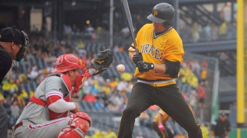If Major League Baseball goes ahead with a possible realignment, the Phillies and Pirates would play in the same division.