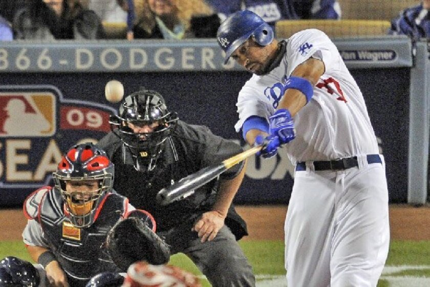 The Dodgers' Matt Kemp hits a two-run homer in the first inning in Game 1 of the NL Division Series in Los Angeles. (Mark J. Terrill / Associated Press)