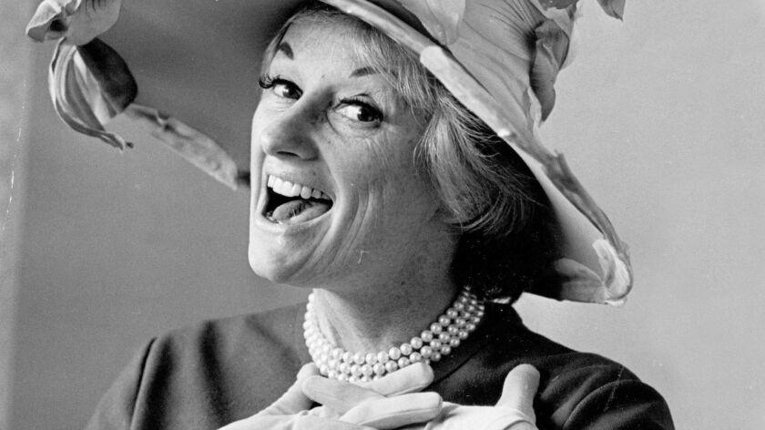 Phyllis Diller modeling a Raymond Hudd-designed hat in 1966.
