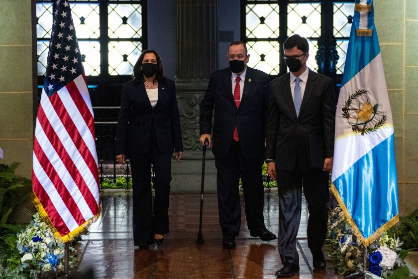 Kamala Harris with Guatemalan President Alejandro Giammattei flanked by flags