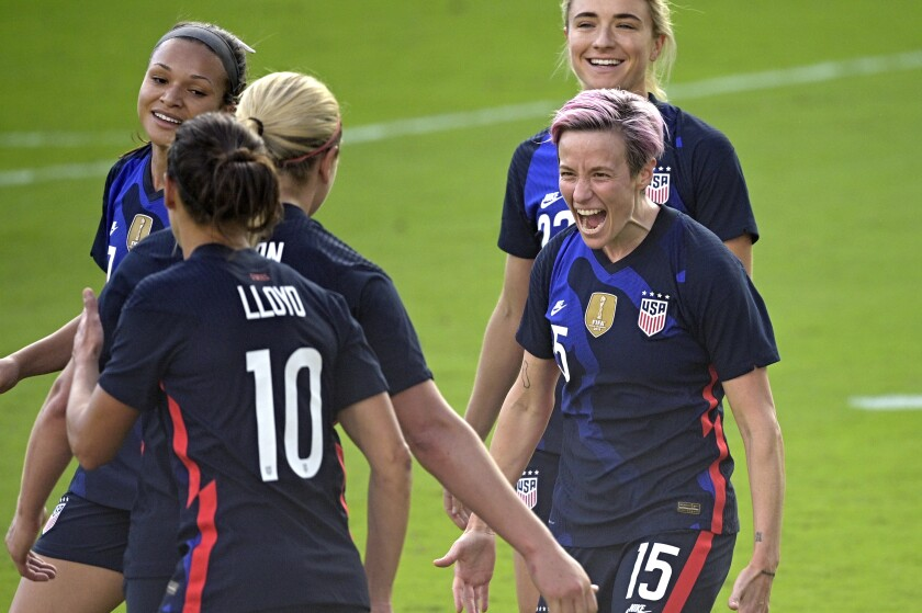 Megan Rapinoe, front right, celebrates with teammates after scoring a goal.