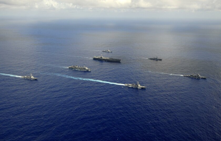 Ships from the John C. Stennis Carrier Strike Group are underway in the western Pacific Ocean.