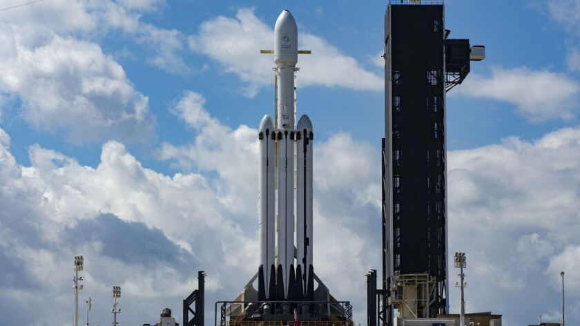 This Wednesday, April 10, 2019 photo made available by SpaceX shows a Falcon Heavy SpaceX rocket on