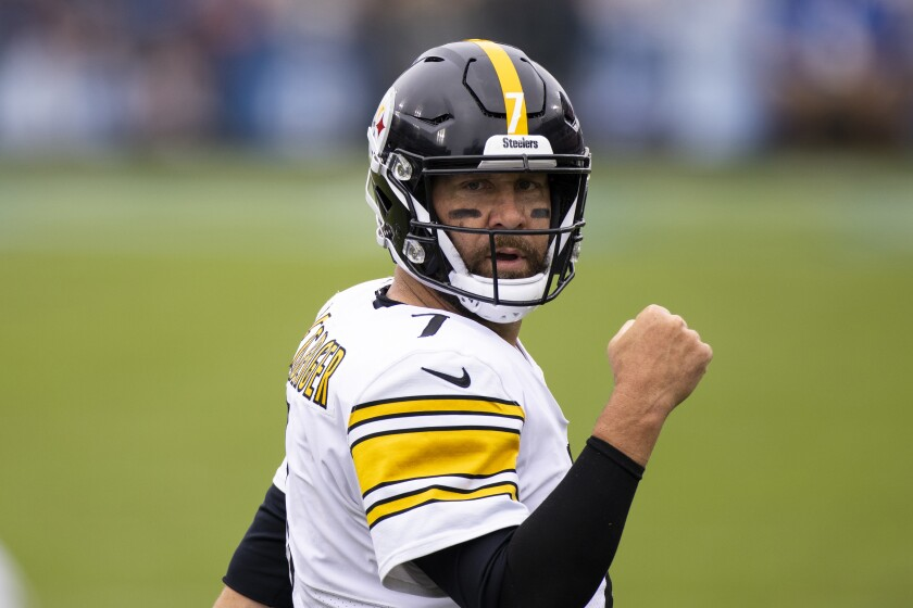 FILE - Pittsburgh Steelers quarterback Ben Roethlisberger celebrates a touchdown against the Tennessee Titans during the first half of an NFL football game in Nashville, in this Sunday, Oct. 25, 2020, file photo. Ben Roethlisberger is returning for an 18th season with the Pittsburgh Steelers and is taking a pay cut to do it. The team and the two-time Super Bowl winner announced on Thursday, March 4, 2021, they have agreed on a new contract that assures the 39-year-old will be back in 2021.(AP Photo/Brett Carlsen, File)
