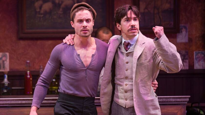 """Philippe Bowgen (left) as Pablo Picasso and Justin Long as Albert Einstein in the Old Globe Theatre's """"Picasso at the Lapin Agile."""""""
