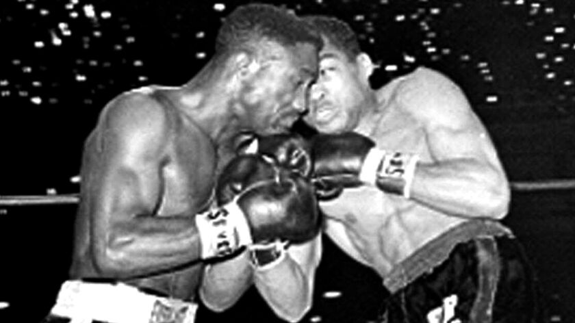 In this March 21, 1963, photo, defending featherweight champion Davey Moore trades punches with Sugar Ramos during the first round of a scheduled 15-round fight in Los Angeles. Moore later died.