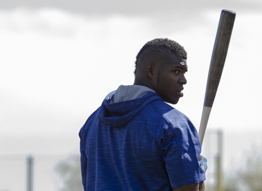 Dodgers outfielder Yasiel Puig looks back at cheering fans before taking batting practice during spring training at Camelback Ranch on Feb. 27