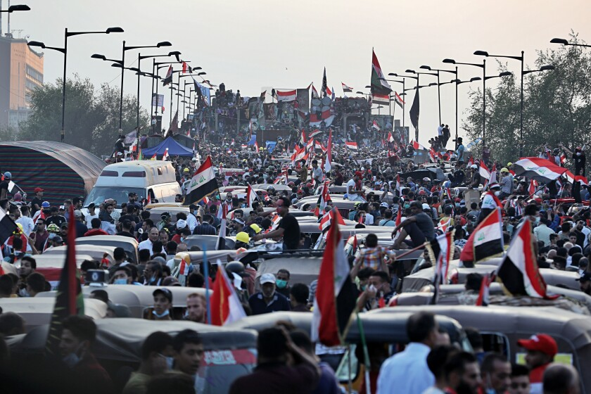 Anti-government protesters gather on the Joumhouriya closed bridge leading to the Green Zone government areas during ongoing protests in Baghdad, Iraq, Sunday, Nov. 3, 2019. (AP Photo/Khalid Mohammed)