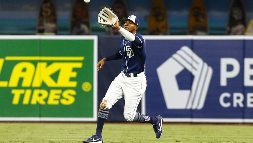 Padres right fielder Edward Olivares (82) catches a fly ball from Rangers third baseman Diosbel Arias (73) in the fifth inning.