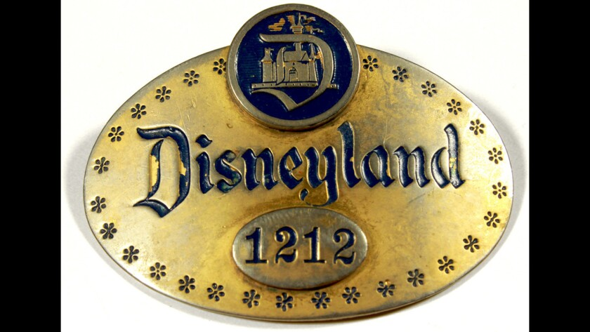 An original Disneyland cast member badge from opening day on July 17, 1955. Amid COVID-related headwinds, financial analysts will be paying close attention to a quarterly earnings call.