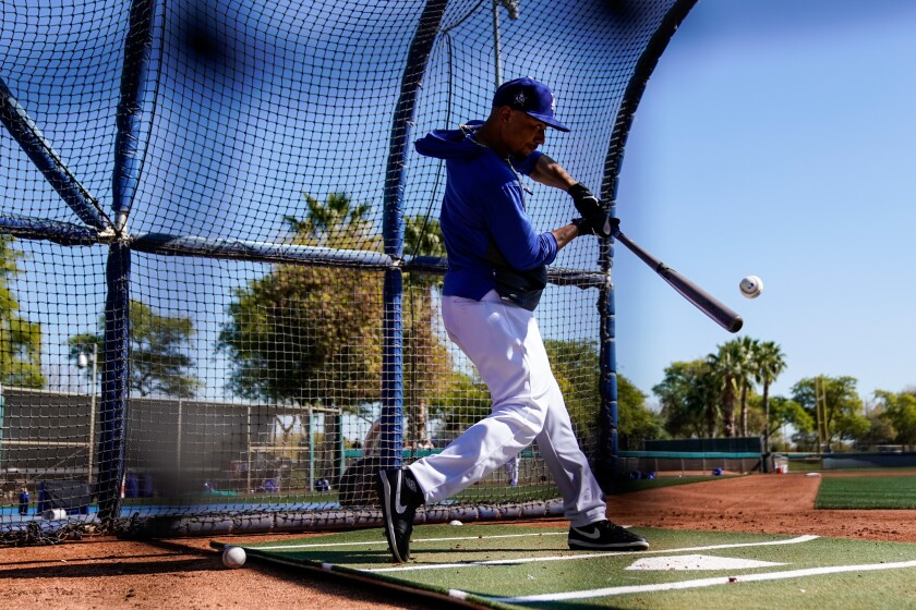 Newcomer Mookie Betts takes batting practice during a Dodgers workout this spring.