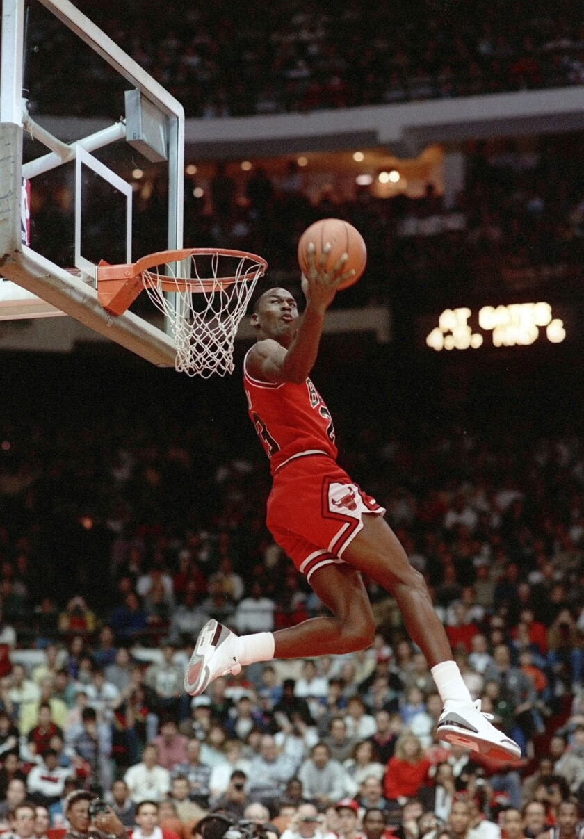 FILE - In this Feb. 6, 1988, file photo, Chicago Bulls' Michael Jordan dunks during the slam-dunk competition of the NBA All-Star weekend in Chicago. Jordan left the old Chicago Stadium that night with the trophy. To this day, many believe Wilkins was the rightful winner. (AP Photo/John Swart)