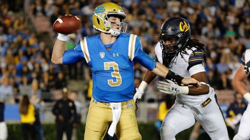 PASADENA, CA - NOVEMBER 24, 2017: UCLA Bruins quarterback Josh Rosen (3) scampers away from incomin