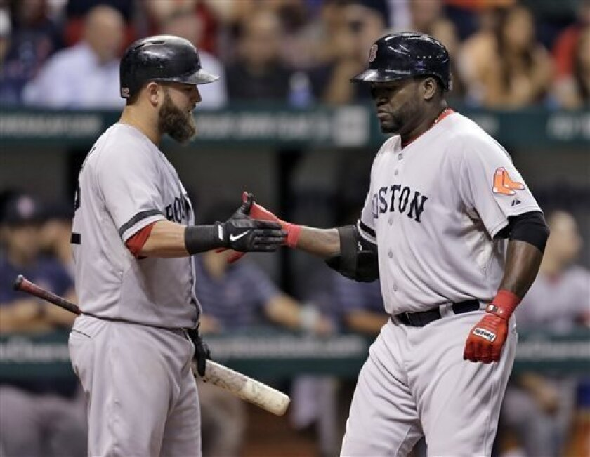 Boston Red Sox's David Ortiz, right, celebrates with on-deck batter Mike Napoli after his sixth-inning home run off Tampa Bay Rays starting pitcher Jeremy Hellickson during a baseball game Thursday, Sept. 12, 2013, in St. Petersburg, Fla. (AP Photo/Chris O'Meara)