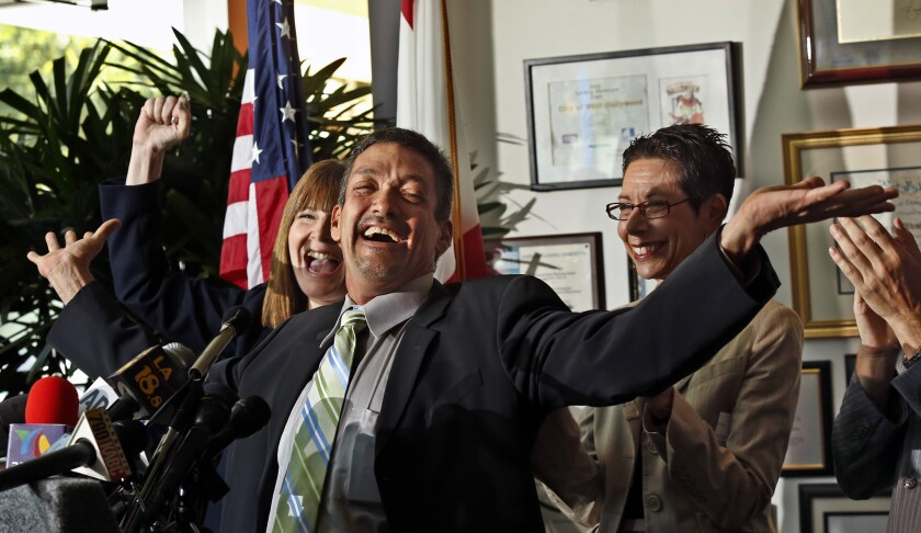 West Hollywood Mayor John Duran, pictured at a 2013 news conference. Duran on Monday said he would give up the title of mayor, citing health reasons. The move comes amid sexual harassment allegations.