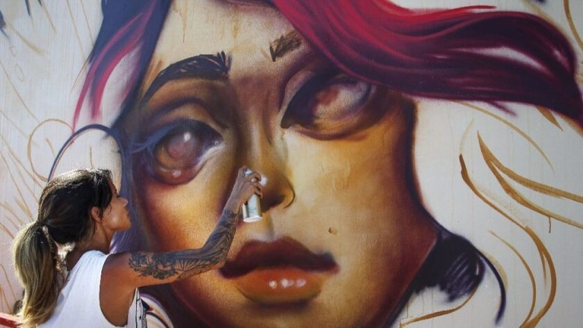 Tatiana Suarez does a live painting at the 2016 KAABOO Del Mar festival, which will have even more a