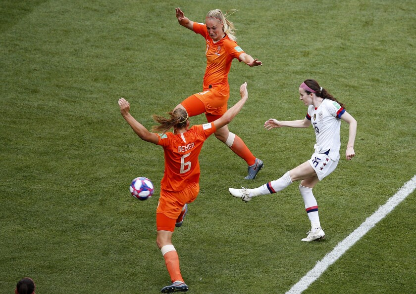 U.S. midfielder Rose Lavelle shoots between two Dutch defenders to score the United States' second goal in the Women's World Cup final on Sunday.
