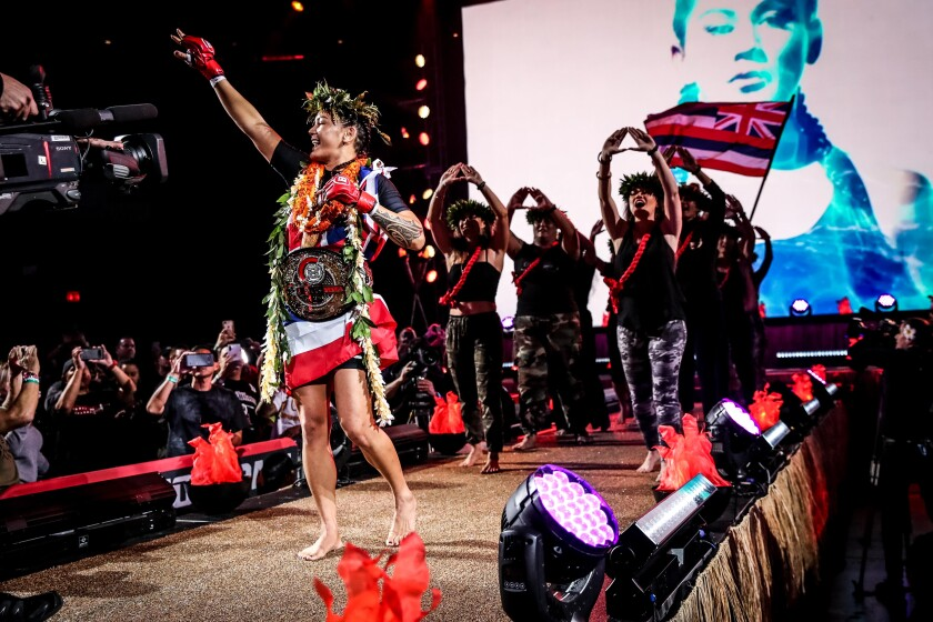 La Mesa MMA champ Ilima-Lei Macfarlane makes her entrance for the most recent title defense Dec. 21 in Honolulu.