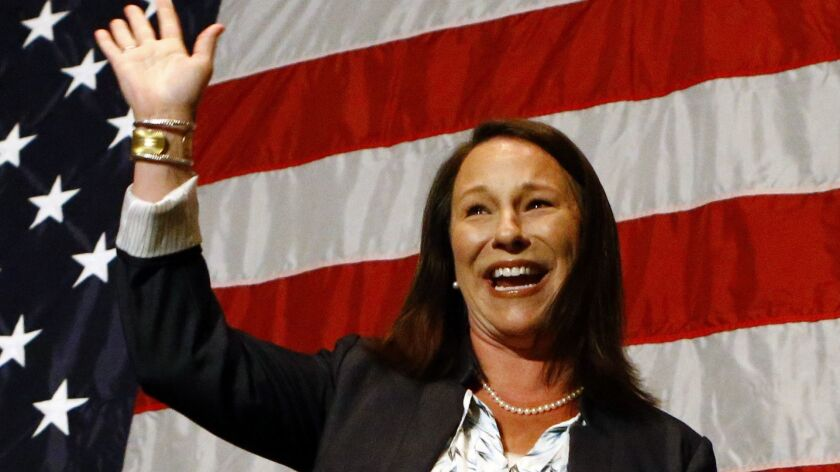 Alabama Rep. Martha Roby waves to supporters during the watch party as she wins the runoff election Tuesday in Montgomery, Ala.