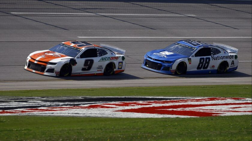 Chase Elliott (9) leads Monster Energy NASCAR Cup Series driver Alex Bowman (88) through the trip ov
