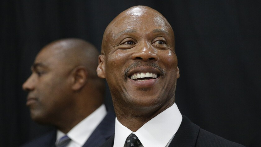 Lakers Coach Byron Scott smiles during the team's media day in El Segundo on Sept. 29.