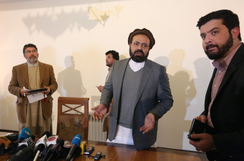 Hezb-i-Islami Party official Amin Karim, second from right, speaks after a news conference in Kabul, Afghanistan, in March.