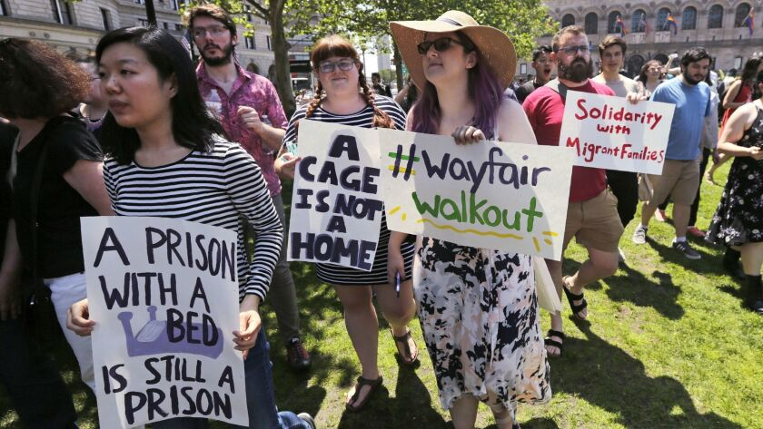 Employees of Wayfair march to Copley Square in protest prior to their rally in Boston, Wednesday, Ju