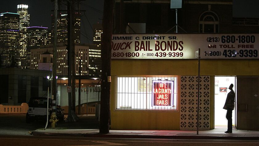 Gauthier, Robert –– – 093232.ME.0207.bail1.RCG –– The lights of downtown Los Angeles shine behind th