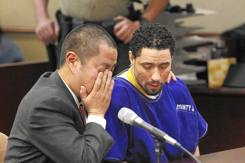 Defense attorney Al Kim, left, and Alex Jackson listen as Vincent Jackson, not pictured, pleads for leniency for his brother.