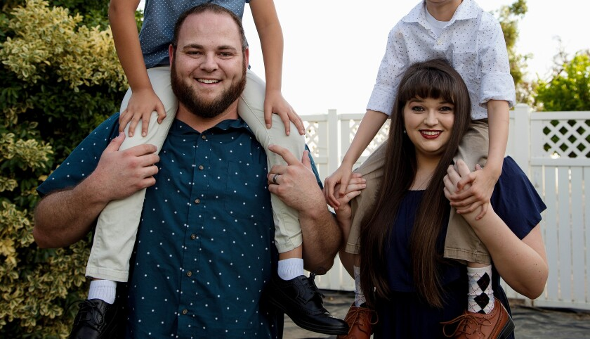 Stephanie Rivero and Ryan Cameron carry their foster sons.